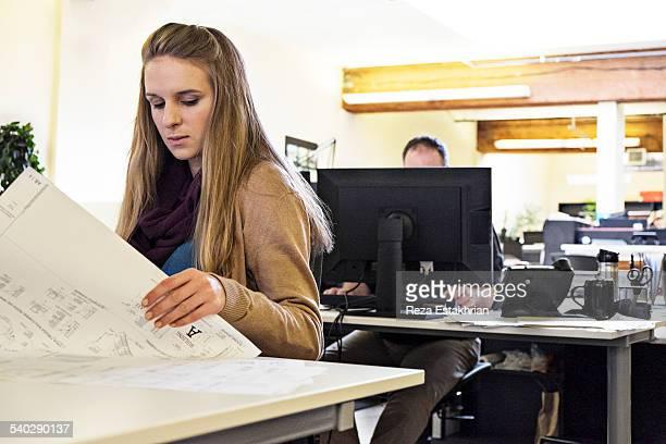 Woman checks plans