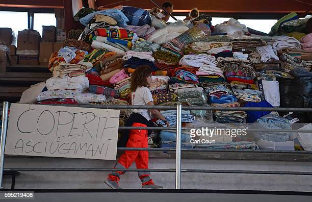 A woman checks relief supplies delivered for earthquake victims on August 25 2016 in Amatrice Italy The death toll in the 62 magnitude earthquake...