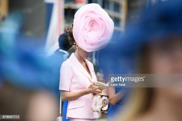 A woman checks the racecard after arriving on day 1 of Royal Ascot at Ascot Racecourse on June 19 2018 in Ascot England Royal Ascot is Britain's most...