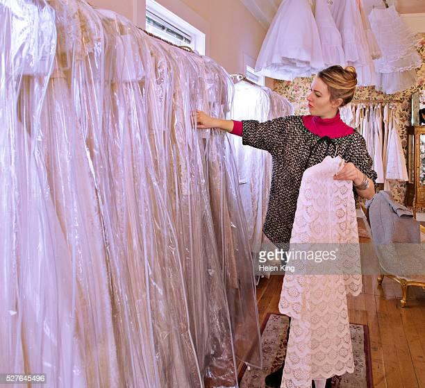 Woman checks through bridal gowns