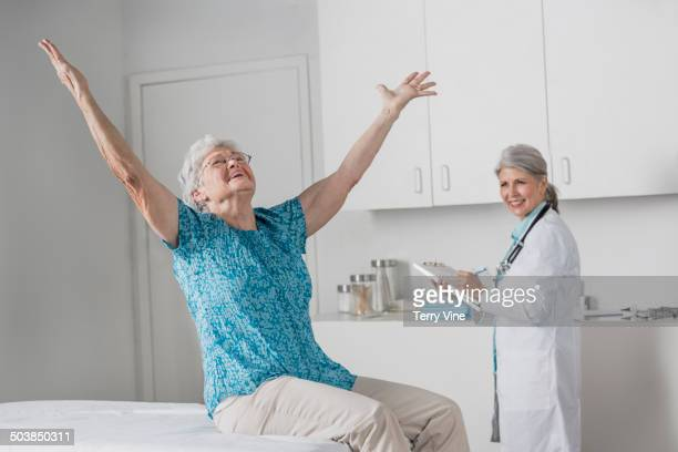 Woman cheering in doctor's office