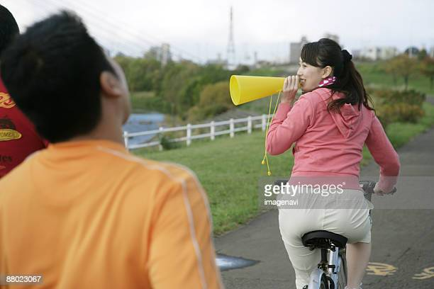 a woman cheering up jogging man - metabolic syndrome stock pictures, royalty-free photos & images
