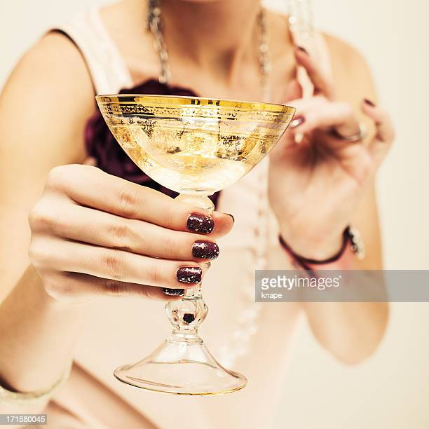 woman cheering with champagne - champagne coloured stock photos and pictures