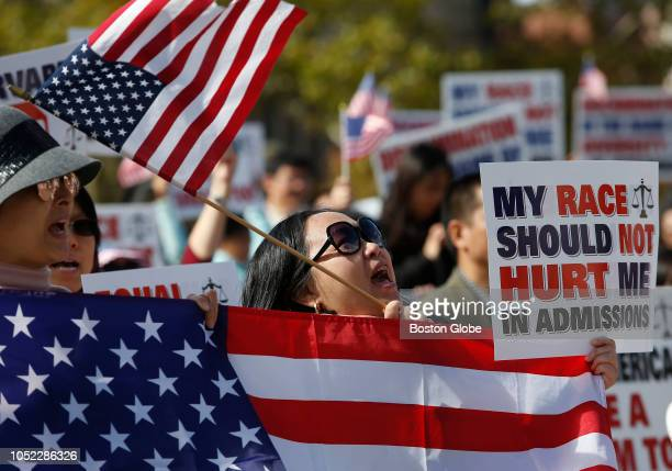 A woman cheers at a rally in Boston's Copley Square to support Students for Fair Admissions' lawsuit against Harvard University and to protest...