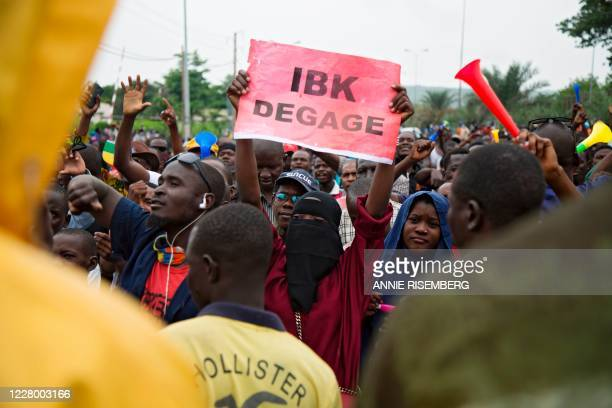 TOPSHOT A woman cheers during a protest organised by M5RFP who are calling for Malian President Ibrahim Boubacar Keita to resign in Bamako on August...