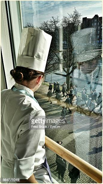 Woman Chef Contemplating At Window