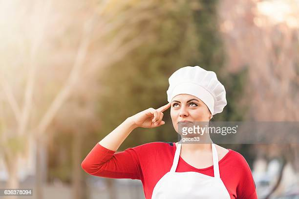 Woman Chef thinking bokeh background