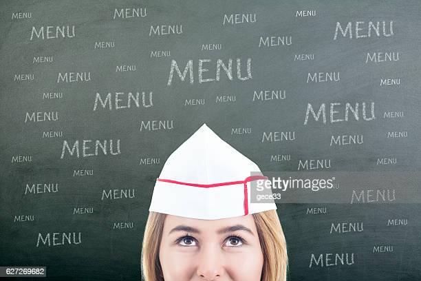 Woman Chef thinking on Blackboard