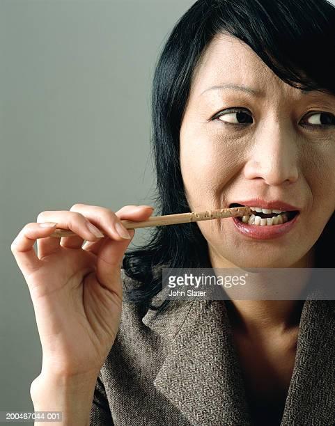 https www gettyimages com au photos biting pencil