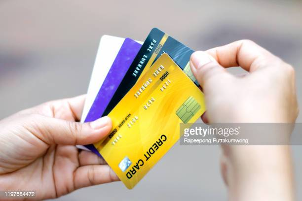 woman choose one credit card from many - fee stock pictures, royalty-free photos & images