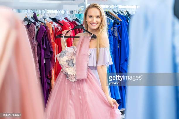 woman choose pink evening dress - evening wear stock pictures, royalty-free photos & images