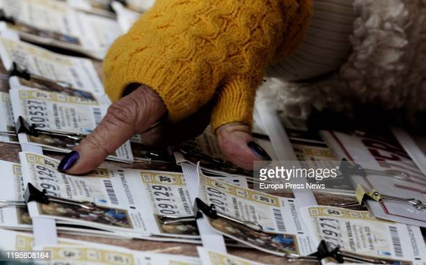 A woman chooses El Niño 2020 Lottery tickets on December 23 2019 in Madrid Spain