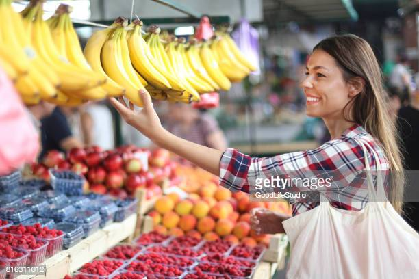Woman choosing bananas