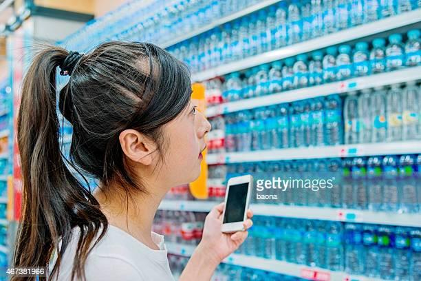 woman choosing bottled water