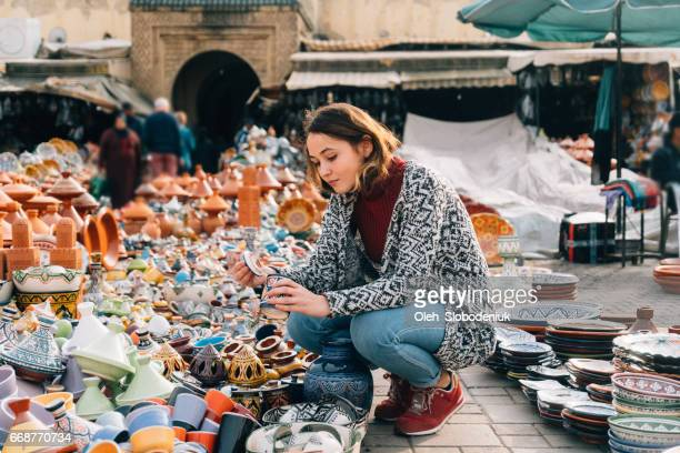 woman choosing ceramic  in shop in meknes, morocco - morocco stock pictures, royalty-free photos & images