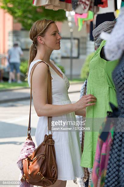 Woman choosing clothes at a shop