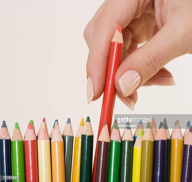 Woman choosing colored pencil