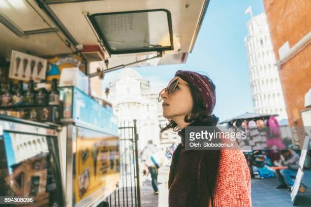 woman choosing gelato in pisa, italy - gelato italiano foto e immagini stock