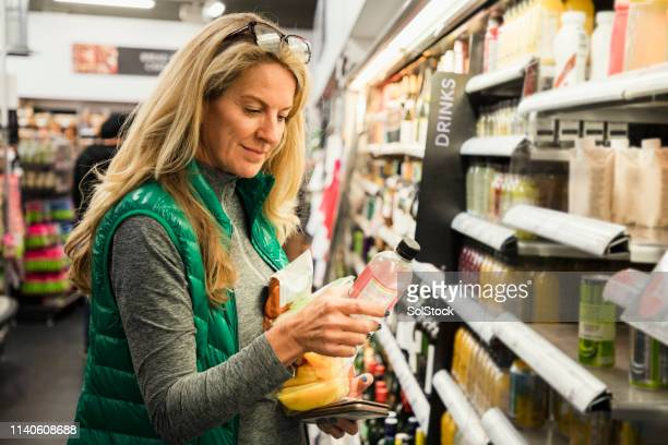 woman choosing her lunch - merchandise stock pictures, royalty-free photos & images