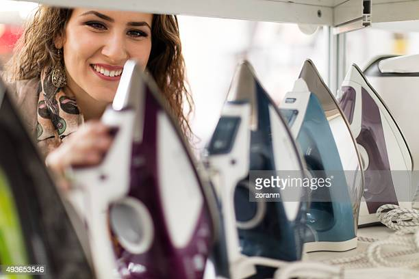 Woman choosing iron