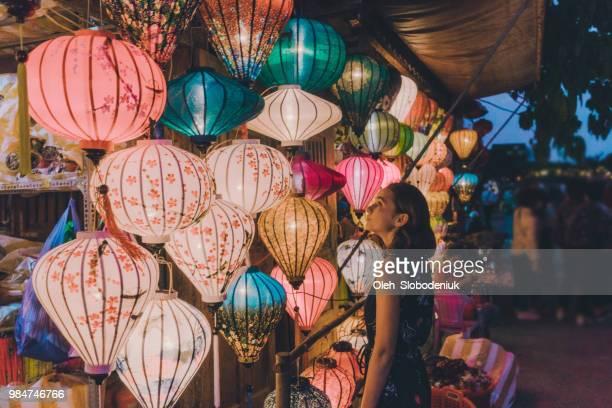 Woman choosing lanterns in Hoi An