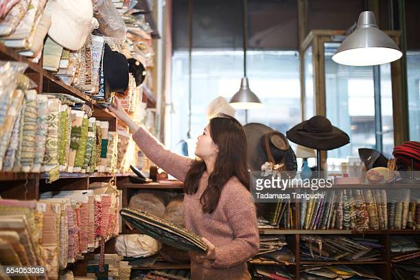 Woman choosing material