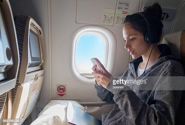 Woman choosing music in airplane