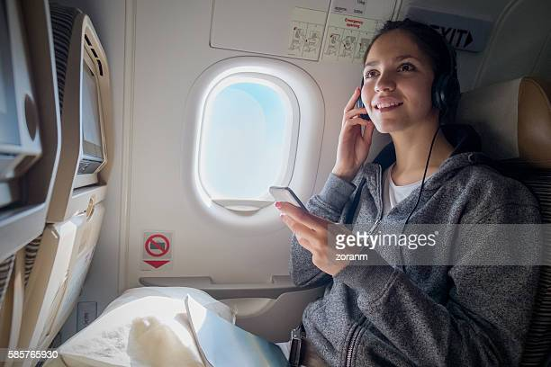 Woman choosing music in airplane