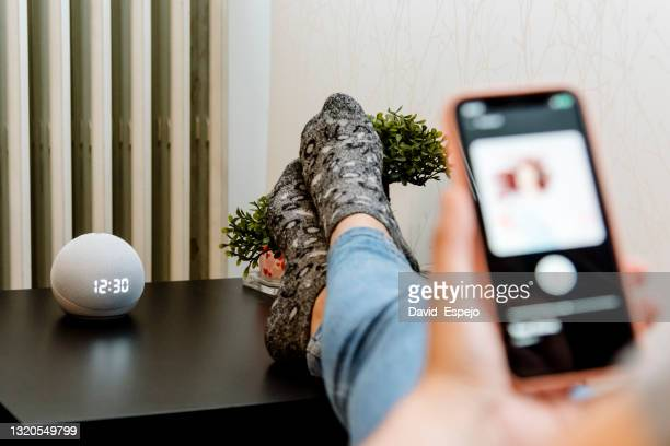 woman choosing music on her cell phone - member of congress stock pictures, royalty-free photos & images