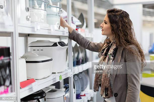woman choosing new steamer - appliance stock pictures, royalty-free photos & images