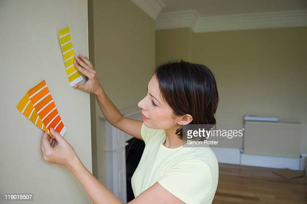 Woman choosing paint color in new home