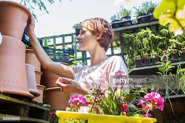 woman choosing plant pot in garden center. - pot plant stock pictures, royalty-free photos & images