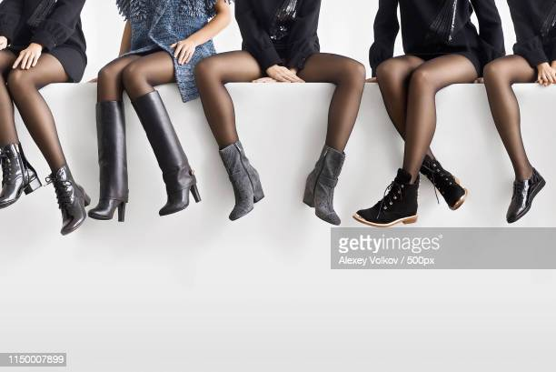 woman choosing right shoes - long nylon legs stock pictures, royalty-free photos & images