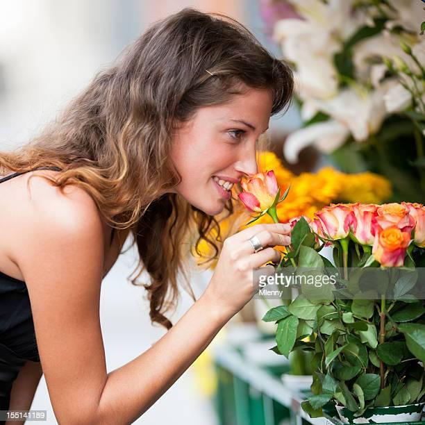Woman choosing rose at flower market