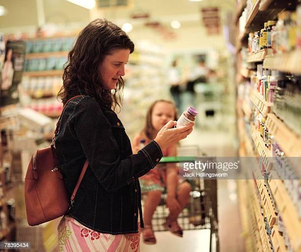 Woman choosing vitamins