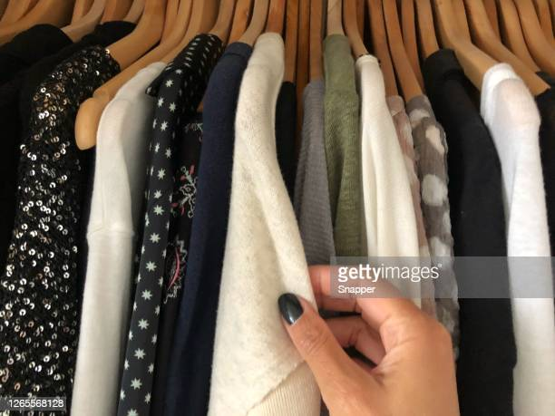woman choosing what to wear - top garment stock pictures, royalty-free photos & images