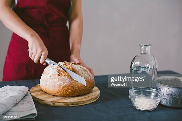 Woman chopping fresh hand made bread