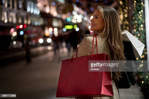 woman christmas shopping - national holiday stock pictures, royalty-free photos & images