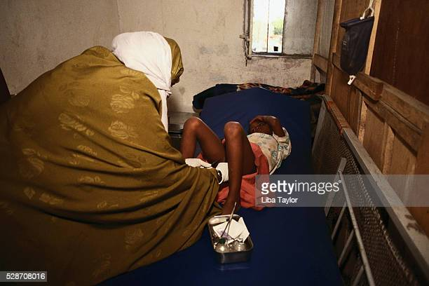 woman circumcising girl - beschneidung stock-fotos und bilder