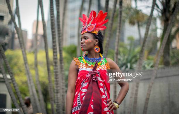 A woman clad in a traditional Zulu outfit looks on during the Indoni SA Cultural Festival on October 7 2017 in Durban The Indoni festival a threeday...