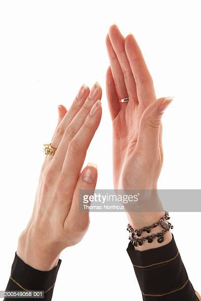 woman clapping, close-up of hands - 袖 ストックフォトと画像