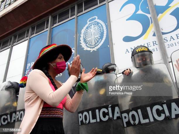 Woman clapping in front of the police when feminist demonstrators using masks, due to Covid-19, organizes a sit-in in front of the prosecutor´s...