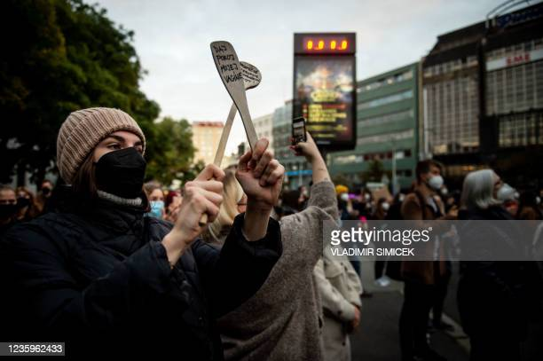 Woman claps with wooden spoons during a protest against a new legislation relating abortions in Bratislava, Slovakia on October 18, 2021.