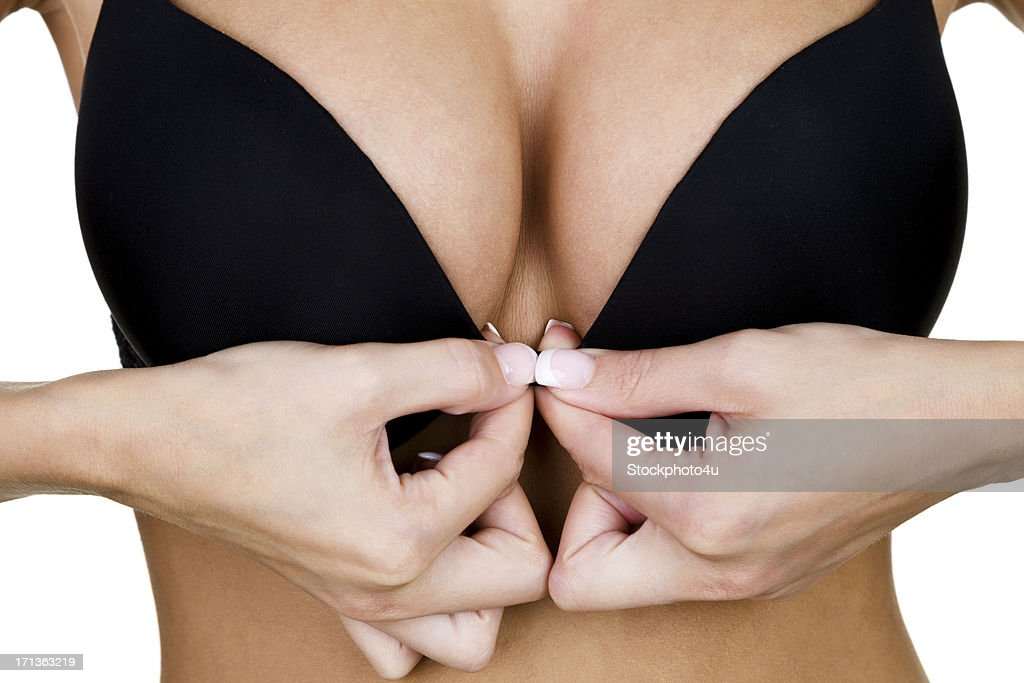 Woman clasping her bra : Stock Photo