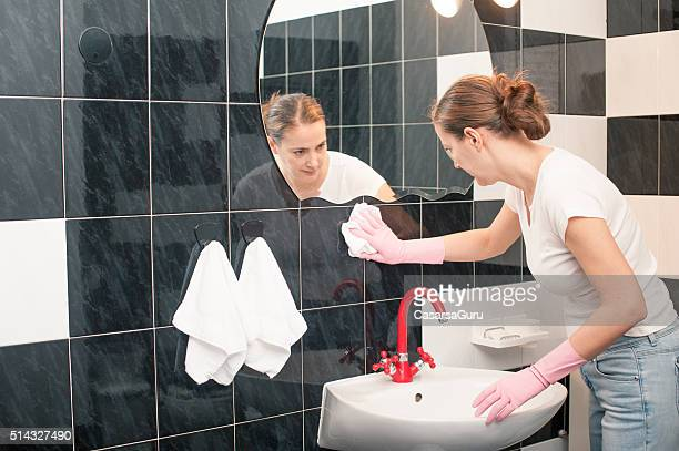 Woman Cleaning Bathroom Tiles
