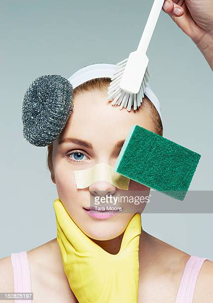 woman cleaning face with household objects - washing up glove stock pictures, royalty-free photos & images