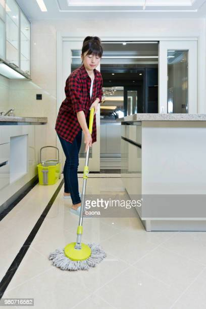 Woman cleaning floor in the kitchen