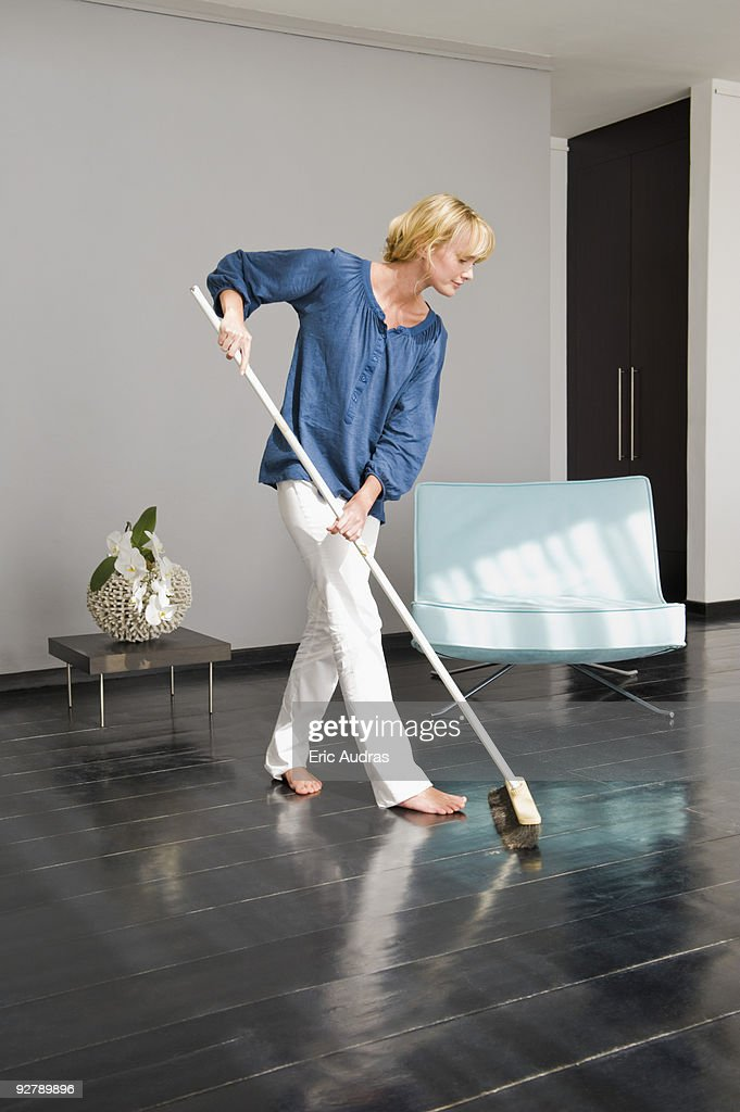 Woman cleaning floor with a mop : Stock Photo