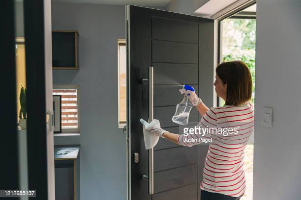 woman cleaning front door - disinfection stock pictures, royalty-free photos & images