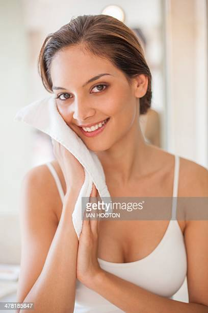 Woman cleaning her face